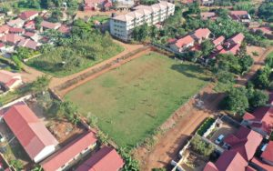 El Cambio Academy Uganda aerial view football pitch
